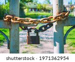 Old Padlock On A Chain On The...