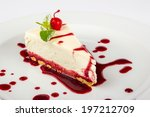 classic cheesecake in a raspberry syrup decorated with cherries and mint leaves - stock photo