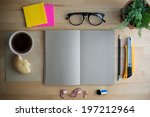 working on a wooden table | Shutterstock . vector #197212964