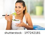 healthy young woman eating... | Shutterstock . vector #197242181