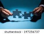 closeup of businessman joining... | Shutterstock . vector #197256737