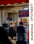 Small photo of Street vendor selling goods on the night before Eid Day at Gerrard, Toronto, Canada