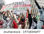 Small photo of New York, NY - May 11, 2021: Hundreds of people participated in rally and march in support of Palestine on 42nd street in Manhattan