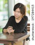 woman using smart phone in...   Shutterstock . vector #197284415
