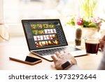 Woman editing digital photos on laptop computer