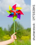 Child Hand Holding Pinwheel...