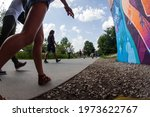 Small photo of Atlanta, GA USA - July 6 2019: Low-angle view of people walking along the public recreational space of the Atlanta Beltline near the Old Fourth Ward Park, on July 6, 2019 in Atlanta, GA.