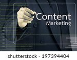 Businessman Pointing At Conten...