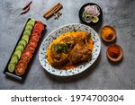 Small photo of Popular Indian mughal dish chicken chap prepared with big pieces of chicken meat in rich spicy gravy. A popular item of the mughal cuisine found in restaurants across India. Top view.
