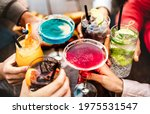Small photo of People hands toasting multicolored fancy drinks - Young friends having fun together drinking cocktails at happy hour - Social gathering party time concept on warm vivid filter - Shallow depth of field
