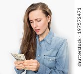 young tired woman with money on ...   Shutterstock . vector #197573471