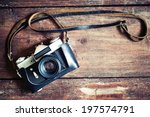 old retro camera on vintage... | Shutterstock . vector #197574791
