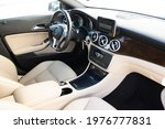 Small photo of Florid, year 2017: interior of a Mercedes-Benz CLA. Beige leather and wood parts.