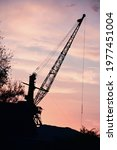 Silhouette Of A Harbor Crane On ...