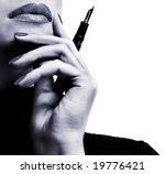 Sexy businesswoman teacher student woman girl holding a pen in her hand lipstick lipgloss makeup fountain pen thinking - stock photo