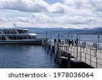 Small photo of Ship named Pfanennstiel arriving at gangplank at City of Zurich
