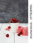 white mug of fresh cherries on... | Shutterstock . vector #197828981