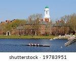 People rowing, running and walking around Harvard University in the spring