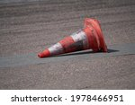 Background with traffic cone on road track