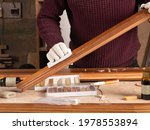The Restorer Restores A Wooden...