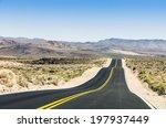 Straight Road Between Hills In...