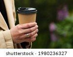 female hand holding disposable...   Shutterstock . vector #1980236327