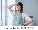woman indoors | Shutterstock . vector #198055277
