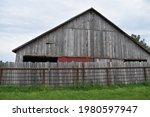 Old Wooden Barn In A Field