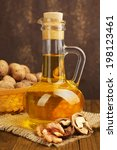 walnut oil and nuts on wooden... | Shutterstock . vector #198123461