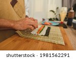 male hands close up rolling...   Shutterstock . vector #1981562291