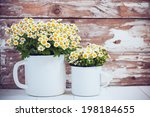 Two Vintage Enamel Mugs With...