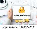 Small photo of Russia Moscow 06.05.2021 Pancake swap logo.Cryptocurrency decentralized exchange DEX, tablet.Trading blockchain platform to swap,buy,sell crypto token,digital coin Bitcoin,Ethereum.Business,investing.