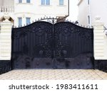 Black Gates With A Wrought Iron ...