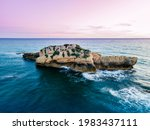 Small Rocky Island On Purple...