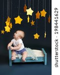 baby sitting in bed  looking up ... | Shutterstock . vector #198441629