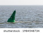 Green Conical Buoy Floats In...