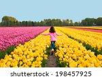 Girl Running In Yellow Tulip...