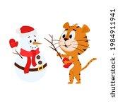 a tiger makes a snowman. cute... | Shutterstock .eps vector #1984911941