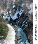 Shirohige Waterfall  in that it flows from an underground river. The watefall is particularly stunning in the winter when frost-encrusted trees and shimmering icicles showcase the blue ravine below