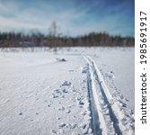 ski tracks in fresh fallen snow ... | Shutterstock . vector #1985691917