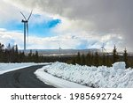snowy road and dark clouds in... | Shutterstock . vector #1985692724