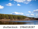 A Clear Lake In A Green Forest. ...