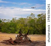 A Drone Hovers Over A Burnt Out ...