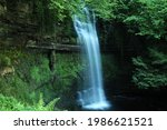 Glencar Waterfall, a watefall located in woodland near Glencar Lough in County Leitrim, ireland