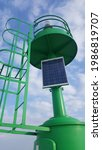 A Green Lighthouse With Solar...