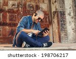 handsome young man listening to ... | Shutterstock . vector #198706217