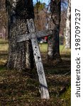 Leaning Old Wooden Cross In...
