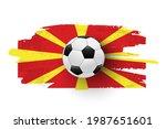 realistic soccer ball on flag... | Shutterstock .eps vector #1987651601