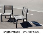 Two Empty Wooden Chairs Stands...