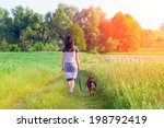 Young Woman With Dog Walking I...